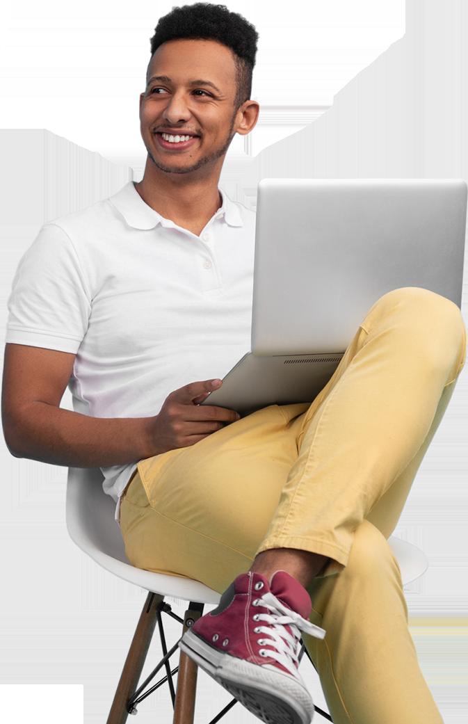 man smiling while using a laptop