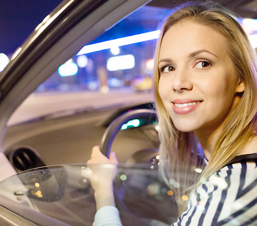 woman smiling and driving