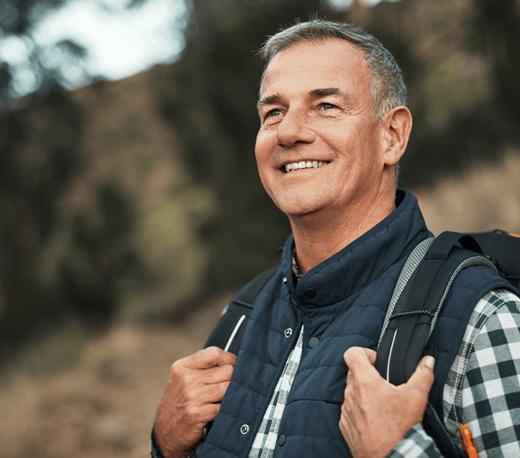 mature man smiling outdoors