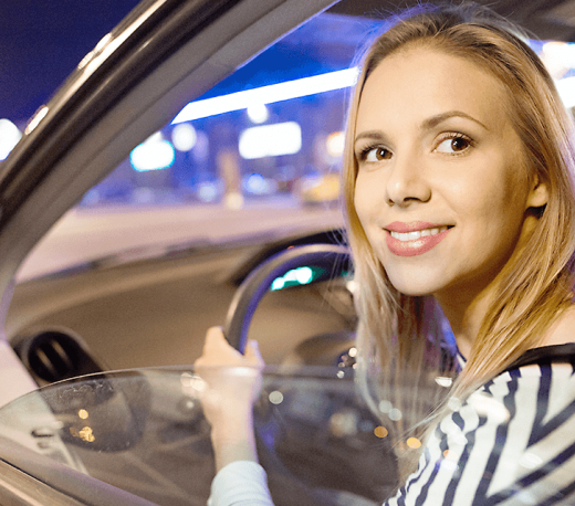 woman smiling in a car